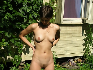 Short hair wife naked in garden