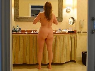 Unaware wife in hotel bathrooms