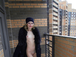 Blonde flashing in balcony