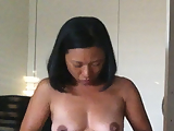 Asian wife getting dressed
