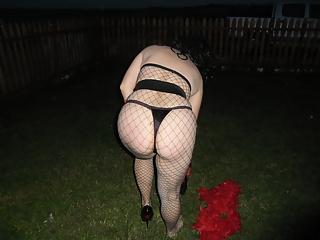 Amateur wearing fishnets in her backyard