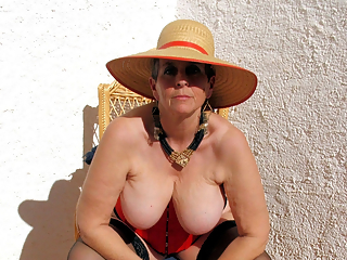 Granny sunbathing naked and posing to camera
