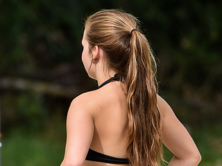 Teen in bikini playing volleyball