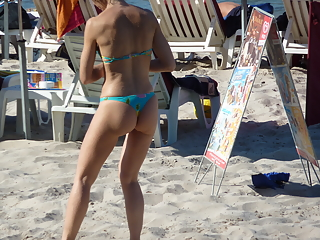 Nice girl in thong on the beach