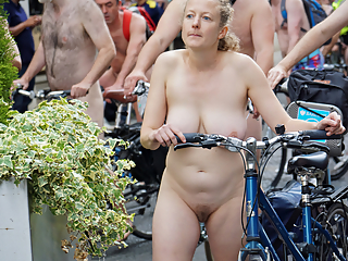 Sexy gals in naked bike riding