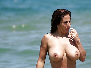 Milf with big tits at the beach