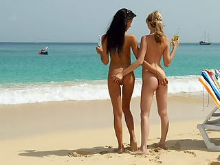 Exhibitionists on a nude beach.