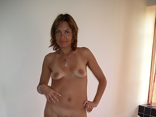Milf naked in bed