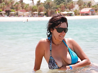 Nipples exposed in the beach