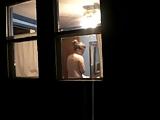 Peeping tom wanks looking through windows