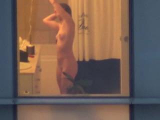 Hotel window bathroom spy