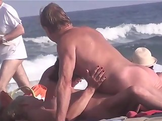 Mature nudist couple having fun