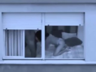 Mature couple fucking by the window