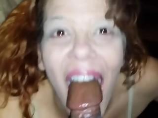 Redhead whore sucks black dick