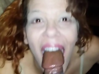 Redhead whore sucks black dick