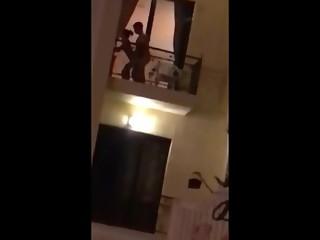 Horny couple fucking in balcony
