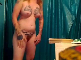 Redhead with lots of tattoos and small bush pussy