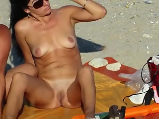 Naked women in the beach