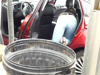 Cleaning car in thigh jeans