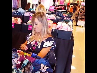 Sexy chick in romper shopping bras