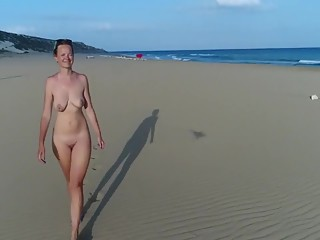 Naked wife in beach