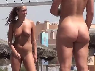 Nude girls playing beach ball