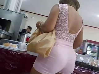 Latin woman in tight pink shorts