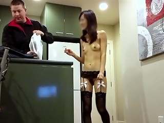 Tight asian exposing her body to food man