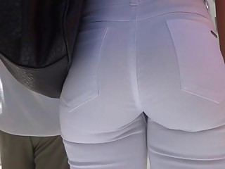 Girl in white jeans nice ass