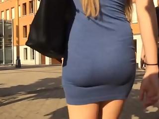 Blonde girl in tight blue dress