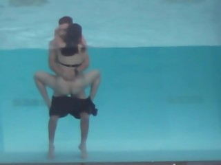 Couple fucking in the hotel pool