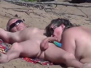 Mature nudist with cock in mouth