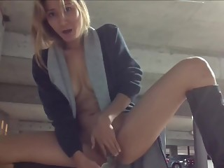 Sexy girl masturbates in public garage