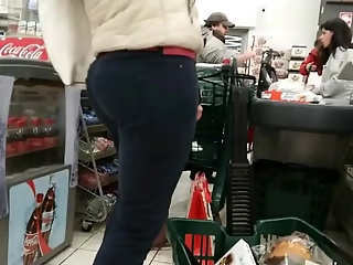 Long hair milf at the supermarket checkout