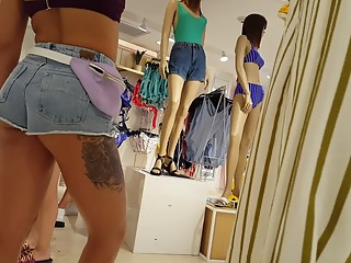 Tattooed sexy girl in shorts