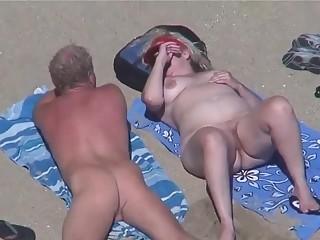Nudist mature couple in the beach