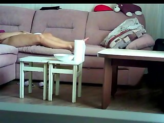 Housewife masturbates in couch