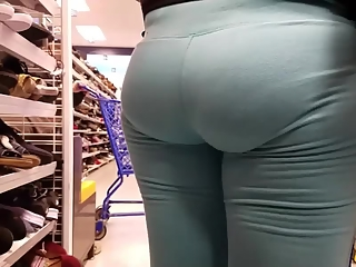 Woman in light blue yoga pants