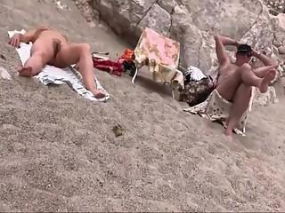 Mature nudist sunbathing