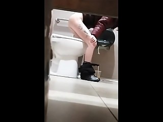 Tattooed leg girl pissing in toilet
